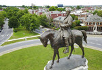 FILE - This Tuesday June 27, 2017 file photo shows the statue of Confederate General Robert E. Lee that stands in the middle of a traffic circle on Monument Avenue in Richmond, Va. Many of the Confederate monuments scattered around the state could soon be coming down after new legislation passed the Virginia legislature. (AP Photo/Steve Helber)