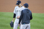 New York Yankees starting pitcher James Paxton, left, is relieved by manager Aaron Boone during the second inning of a baseball game against the Washington Nationals at Nationals Park, Saturday, July 25, 2020, in Washington. (AP Photo/Alex Brandon)