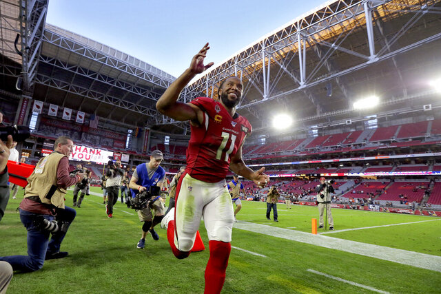 Arizona Cardinals wide receiver Larry Fitzgerald (11) leave the field after f an NFL football game against the Cleveland Browns, Sunday, Dec. 15, 2019, in Glendale, Ariz. The Cardinals won 38-24. (AP Photo/Ross D. Franklin)