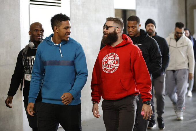 New England Patriots' from left, Jason McCourty, Eric Rowe, Julian Edelman, Trey Flowers, James Develin arrive for a NFL football walkthrough, Saturday, Feb. 2, 2019, in Atlanta, ahead of Super Bowl 53 against the Los Angeles Rams. (AP Photo/Matt Rourke)