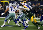 Dallas Cowboys quarterback Dak Prescott (4) is sacked by Green Bay Packers outside linebacker Preston Smith (91) in the first half of an NFL football game in Arlington, Texas, Sunday, Oct. 6, 2019. (AP Photo/Michael Ainsworth)