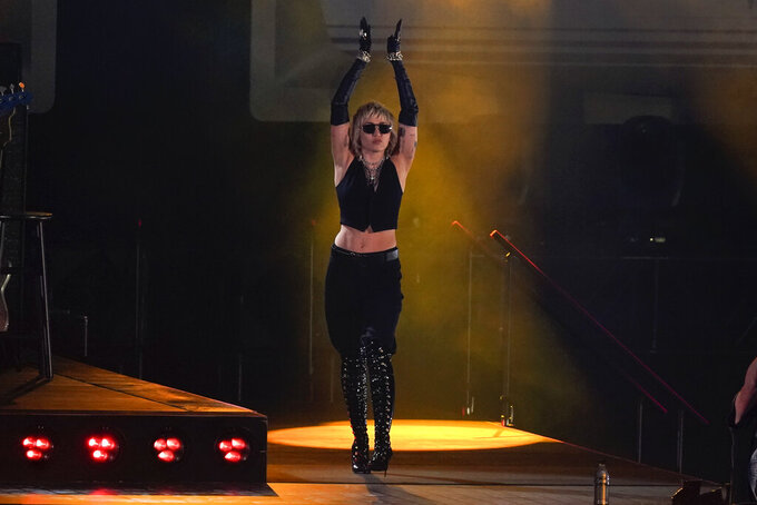 Miley Cyrus performs before a Final Four NCAA college basketball tournament semifinal game between Gonzaga and UCLA, Saturday, April 3, 2021, at Lucas Oil Stadium in Indianapolis. (AP Photo/Michael Conroy)