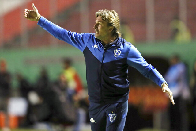 FILE - In this Feb. 18, 2020, file photo, Velez Sarsfield coach Gabriel Heinze directs his players during a Copa Sudamericana soccer match against Aucas at the Gonzalo Pozo Ripalda stadium in Quito, Ecuador.  Hoping to recreate the success of its first coach, Atlanta United hired Argentina's Gabriel Heinze on Friday, Dec. 18, 2020, to manage the Five Stripes, who endured a miserable season just two years after winning the MLS Cup championship. (AP Photo/Dolores Ochoa, File)