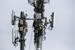 FILE - In this April 17, 2019, file photo workers install equipment on a communications tower in Philadelphia. On Friday, May 3, the U.S. government issues the April jobs report. (AP Photo/Matt Rourke, File)