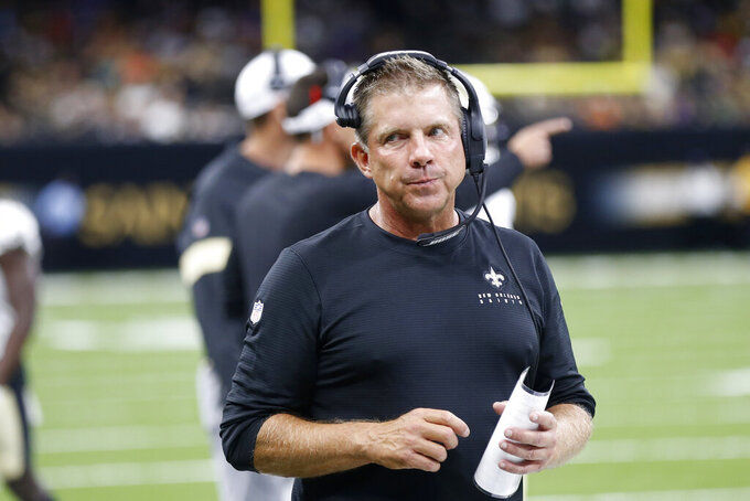 New Orleans Saints head coach Sean Payton walks on the sideline in the first half of an NFL preseason football game against the Minnesota Vikings in New Orleans, Friday, Aug. 9, 2019. (AP Photo/Gerald Herbert)