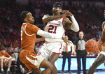 Texas guard Matt Coleman III (2) knocks the ball away from Oklahoma forward Kristian Doolittle (21) during the first half of an NCAA college basketball game in Norman, Okla., Tuesday, March 3, 2020. (Kyle Phillips/The Norman Transcript via AP)