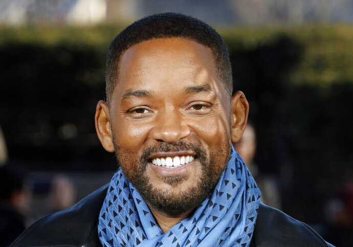 FILE - In this Monday, Jan. 6, 2020, file photo, U.S actor Will Smith poses for photographers during the photo call of