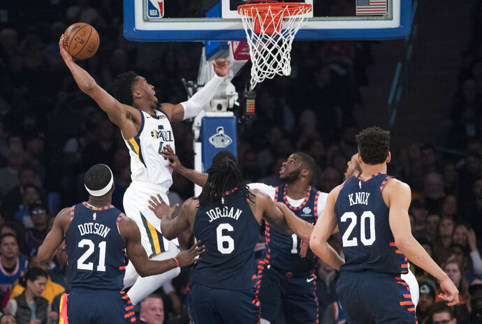 Utah Jazz guard Donovan Mitchell (45) dunks during the first half of the team's NBA basketball game against the New York Knicks, Wednesday, March 20, 2019, at Madison Square Garden in New York. (AP Photo/Mary Altaffer)