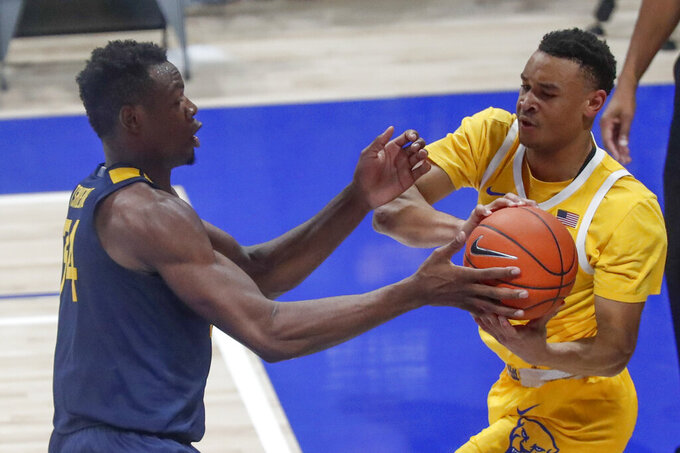 West Virginia's Oscar Tshiebwe, left, pressures Pittsburgh's Trey McGowens (2) who tries to pass during the second half of an NCAA college basketball game, Friday, Nov. 15, 2019, in Pittsburgh. (AP Photo/Keith Srakocic)