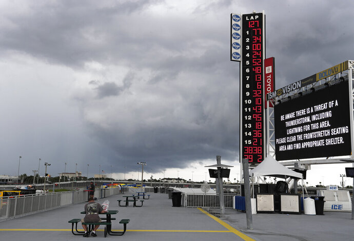 Storm clouds move over the Daytona International Speedway stopping the NASCAR Cup Series auto race at lap 127 of 160 laps Sunday, July 7, 2019, in Daytona Beach, Fla. (AP Photo/John Raoux)