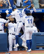 Toronto Blue Jays' Randall Grichuk celebrates with teammates at the dugout after he a hit two-run home run against the New York Yankees inning of a baseball game Friday, Aug. 9, 2019, in Toronto. (Fred Thornhill/The Canadian Press via AP)