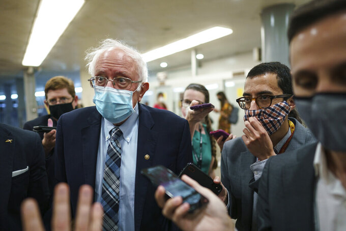 Sen. Bernie Sanders, I-Vt., chair of the Senate Budget Committee, is met by reporters during the vote to start work on a nearly $1 trillion bipartisan infrastructure package, at the Capitol in Washington, Wednesday, July 28, 2021. (AP Photo/J. Scott Applewhite)