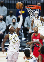 Indiana Pacers guard Aaron Holiday (3) shoots against the Portland Trail Blazers during the first half of an NBA basketball game in Portland, Ore., Thursday, Jan. 14, 2021. (AP Photo/Craig Mitchelldyer)