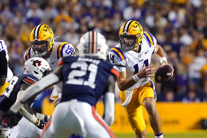 LSU quarterback Max Johnson (14) scrambles in the first half of an NCAA college football game against Auburn in Baton Rouge, La., Saturday, Oct. 2, 2021. (AP Photo/Gerald Herbert)