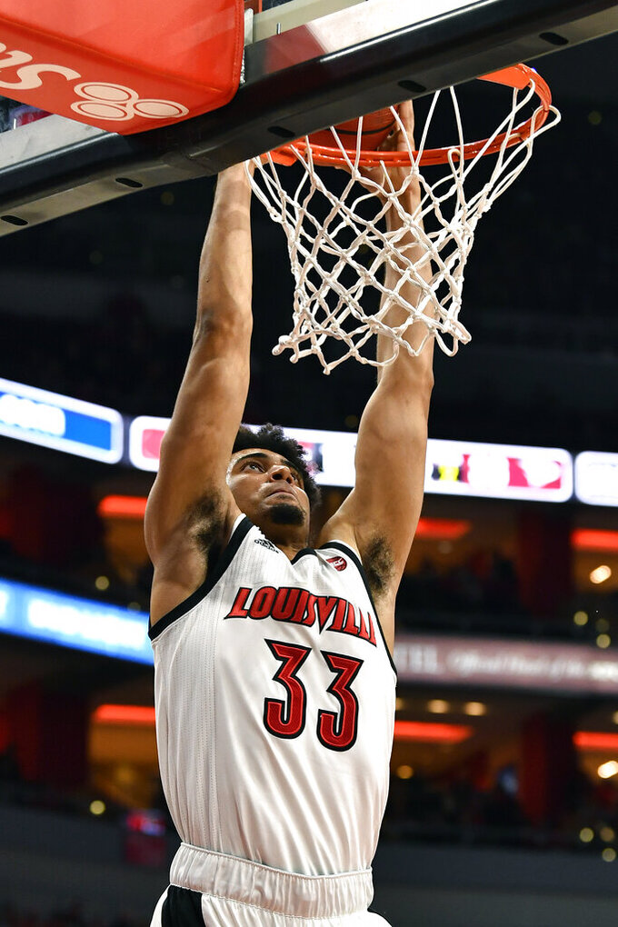 Louisville forward Jordan Nwora (33) goes up for a dunk during the second half of an NCAA college basketball game against North Carolina Central in Louisville, Ky., Sunday, Nov. 17, 2019. (AP Photo/Timothy D. Easley)
