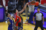Oklahoma City Thunder's Isaiah Roby, center, shoots against Golden State Warriors' Draymond Green, right, and Juan Toscano-Anderson, left, during the first half of an NBA basketball game in San Francisco, Saturday, May 8, 2021. (AP Photo/Jed Jacobsohn)