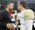 Texas Tech head coach Kliff Kingsbury, left, congratulates Baylor quarterback Charlie Brewer (12) after an NCAA college football game Saturday, Nov. 24, 20178, in Arlington, Texas. (Jerry Larson/Waco Tribune-Herald via AP)