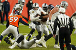 Las Vegas Raiders quarterback Derek Carr (4) is sacked by the Denver Broncos during the second half of an NFL football game, Sunday, Jan. 3, 2021, in Denver. (AP Photo/Jack Dempsey)