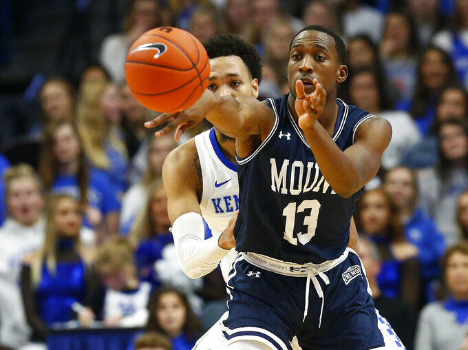 Mount St. Mary's Omar Habwe (13) passes the ball past Kentucky's EJ Montgomery during the first half of an NCAA college basketball game in Lexington, Ky., Friday, Nov. 22, 2019. (AP Photo/James Crisp)