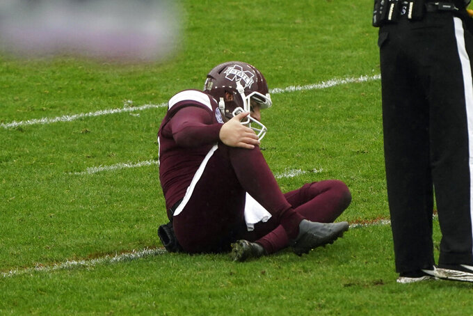 Mississippi State punter Tucker Day (37) sits injured after a punt to Tulsa during the second half of the Armed Forces Bowl NCAA college football game Thursday, Dec. 31, 2020, in Fort Worth, Texas. (AP Photo/Jim Cowsert)