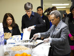 Mayor Lori Lightfoot and first lady Amy Eshleman pass out breakfast to Chicago Public Schools students at a contingency site, Gads Hill Center, Friday,  Oct. 18, 2019. Striking Chicago teachers have returned to the picket lines for a second day as union and city bargainers try to hammer out a contract in the nation's third-largest school district.  (Ashlee Rezin Garcia /Chicago Sun-Times via AP)