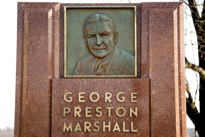 "FILE - In this Dec. 14, 2017, file photo, the George Preston Marshall monument outside RFK stadium in Washington is shown. The Washington Redskins are removing former owner George Preston Marshall from their ring of fame and striking all references to him on their website, a spokesman confirmed Wednesday, June 24, 2020. It's the latest move made to cut ties with the legacy of the team's racist founder, who refused to integrate by signing Black players until ""forced to do so"" in 1962, more than a decade after the rest of the NFL. (AP Photo/Andrew Harnik, File)"