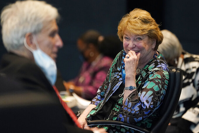 Virginia State Sen. Janet Howell, D-Fairfax, smiles after her remarks on a bill legalizing marijuana during the Senate reconvene session at the Science Museum of Virginia in Richmond, Va., Wednesday, April 7, 2021. (AP Photo/Steve Helber)
