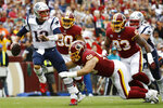 New England Patriots quarterback Tom Brady (12) works under pressure in the pocket against Washington Redskins defensive end Matthew Ioannidis (98) during the first half of an NFL football game, Sunday, Oct. 6, 2019, in Washington. (AP Photo/Patrick Semansky)