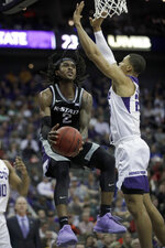 Kansas State guard Cartier Diarra (2) makes a basket while covered by TCU forward Jaedon LeDee (23) during the first half of an NCAA college basketball game in the first round of the Big 12 men's basketball tournament in Kansas City, Mo., Wednesday, March 11, 2020. (AP Photo/Orlin Wagner)