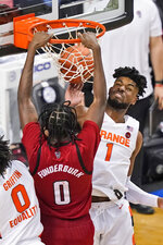 North Carolina State forward DJ Funderburk (0) slams home a dunk as Syracuse forward Quincy Guerrier (1) defends during the second half of an NCAA college basketball game in the second round of the Atlantic Coast Conference tournament in Greensboro, N.C., Wednesday, March 10, 2021. (AP Photo/Gerry Broome)