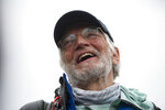 American climber Arthur Muir, 75, gestures as he arrives in Kathmandu, Nepal, Sunday, May 30, 2021. The retired attorney from Chicago who became the oldest American to scale Mount Everest, and a Hong Kong teacher who is now the fastest female climber of the world's highest peak, on Sunday returned safely from the mountain where climbing teams have been struggling with bad weather and a coronavirus outbreak. Arthur Muir, 75, scaled the peak earlier this month, beating the record by another American, Bill Burke, at age 67.  (AP Photo/Bikram Rai)