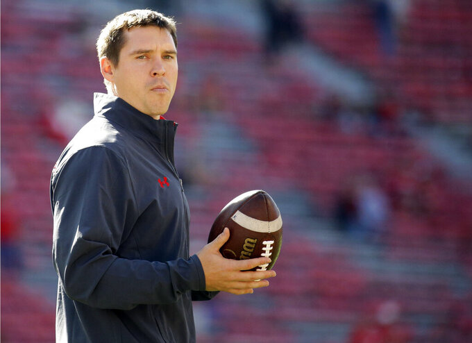 FILE - In this Sept. 9, 2017, file photo, Wisconsin defensive coordinator Jim Leonhard holds a football before an NCAA college football game against Florida Atlantic in Madison, Wis. Wisconsin's defense believes it still has plenty of room for improvement after a season in which it gave up fewer yards and points per game than nearly every other team in the nation. (AP Photo/Aaron Gash, File)