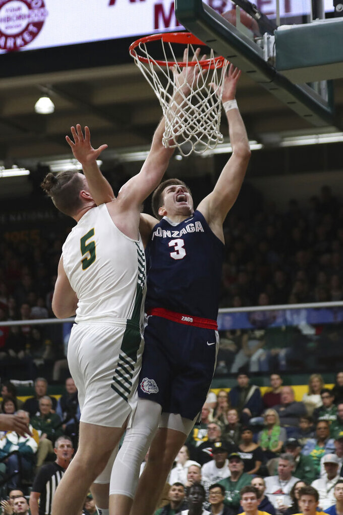 Gonzaga forward Filip Petrusev (3) shoots against San Francisco center Jimbo Lull (5) during the first half of an NCAA college basketball game in San Francisco, Saturday, Feb. 1, 2020. (AP Photo/Jed Jacobsohn)