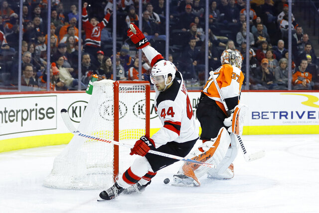 New Jersey Devils' Miles Wood (44) celebrates after scoring against Philadelphia Flyers' Brian Elliott (37) during the third period of an NHL hockey game, Thursday, Feb. 6, 2020, in Philadelphia. (AP Photo/Matt Slocum)