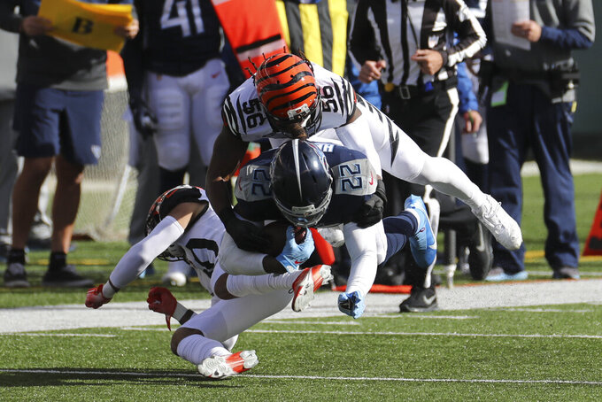 Tennessee Titans' Derrick Henry (22) is tackled by Cincinnati Bengals' Josh Bynes (56) during the first half of an NFL football game, Sunday, Nov. 1, 2020, in Cincinnati. (AP Photo/Jay LaPrete)