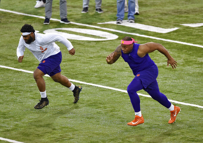 Clemson's Dexter Lawrence, right, and Christian Wilkins runs drills during NFL Pro Day Thursday, March 14, 2019, in Clemson, S.C. (AP Photo/Richard Shiro)