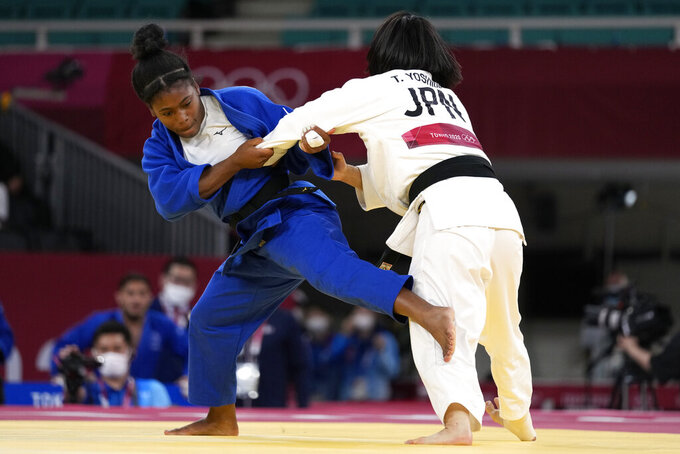 Sarah Leonie Cysique of France, left, and Tsukasa Yoshida of Japan compete during their gold medal match in team judo competition at the 2020 Summer Olympics, Saturday, July 31, 2021, in Tokyo, Japan. (AP Photo/Vincent Thian)