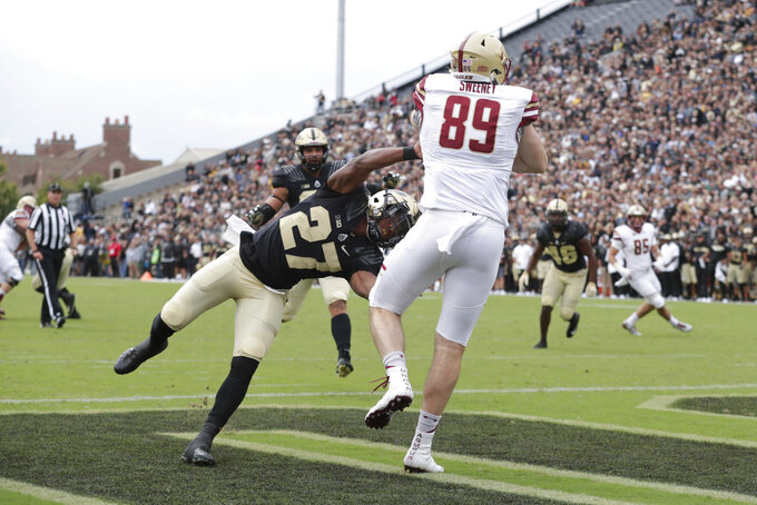 Boston College tight end Tommy Sweeney (89) makes a catch for a touchdown over Purdue safety Navon Mosley (27) during the first half of an NCAA college football game in West Lafayette, Ind., Saturday, Sept. 22, 2018. (AP Photo/Michael Conroy)