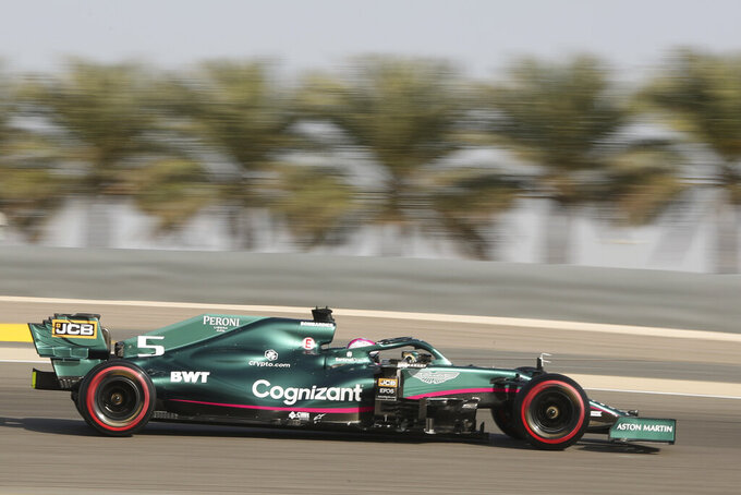Aston Martin driver Sebastian Vettel of Germany steers his car during the third free practice at the Formula One Bahrain International Circuit in Sakhir, Bahrain, Saturday, March 27, 2021. The Bahrain Formula One Grand Prix will take place on Sunday. (AP Photo/Kamran Jebreili)