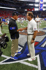 Alabama head coach Nick Saban, right, and Duke head coach David Cutcliffe talk before an NCAA college football game Saturday, Aug. 31, 2019, in Atlanta. (AP Photo/John Bazemore)