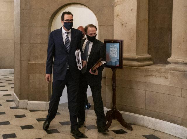 Treasury Secretary Steven Mnuchin arrives at House Speaker Nancy Pelosi's office on Capitol Hill in Washington, Thursday, Aug. 6, 2020. (AP Photo/Carolyn Kaster)