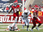 Fresno State's Jalen Cropper (5) runs past Connecticut's Collin McCarthy (91) during the first half of an NCAA college football game in Fresno, Calif., Saturday, Aug. 28, 2021. (AP Photo/Gary Kazanjian)