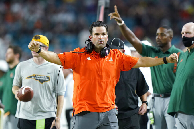 Miami head coach Manny Diaz celebrates after a play during the first half of an NCAA college football game against Appalachian State, Saturday, Sept. 11, 2021, in Miami Gardens, Fla. (AP Photo/Wilfredo Lee)