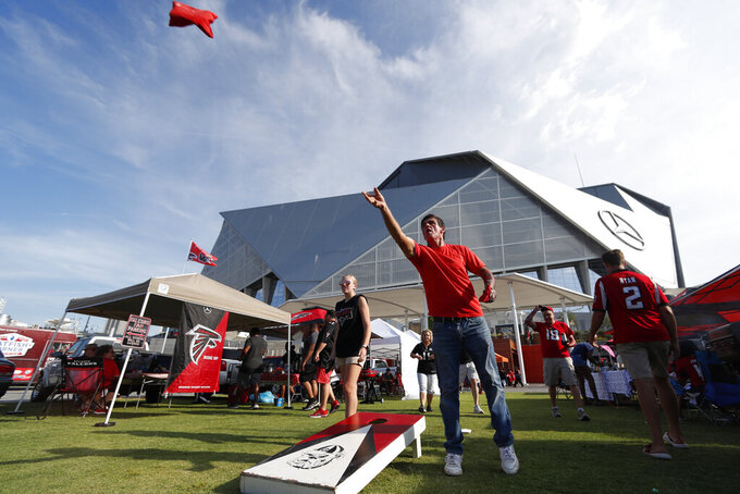 Robert Isbella, of Columbus, Ga., tailgates ahead of an NFL football game, between the Atlanta Falcons and the Philadelphia Eagles, Sunday, Sept. 15, 2019, in Atlanta. (AP Photo/John Bazemore)