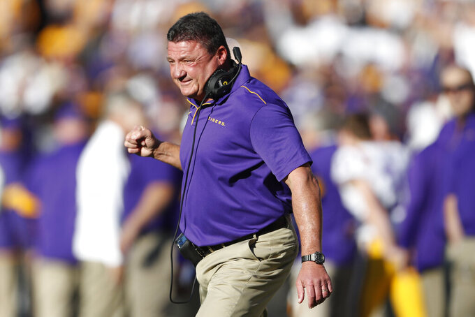 LSU head coach Ed Orgeron reacts after an LSU touchdown in the first half of an NCAA college football game against Alabama, Saturday, Nov. 9, 2019, in Tuscaloosa, Ala. (AP Photo/John Bazemore)