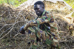 In this photo taken Wednesday, Aug. 28, 2019, 29-year-old opposition fighter Godfrey Oyaka sits at an opposition military camp near the town of Nimule in Eastern Equatoria state, South Sudan. South Sudan's fragile peace deal is faltering Wednesday Oct. 16, 2019, less than one month before the country's president and armed opposition leader are meant to form a unity government and begin the long recovery from a five-year civil war. (AP Photo/Sam Mednick)