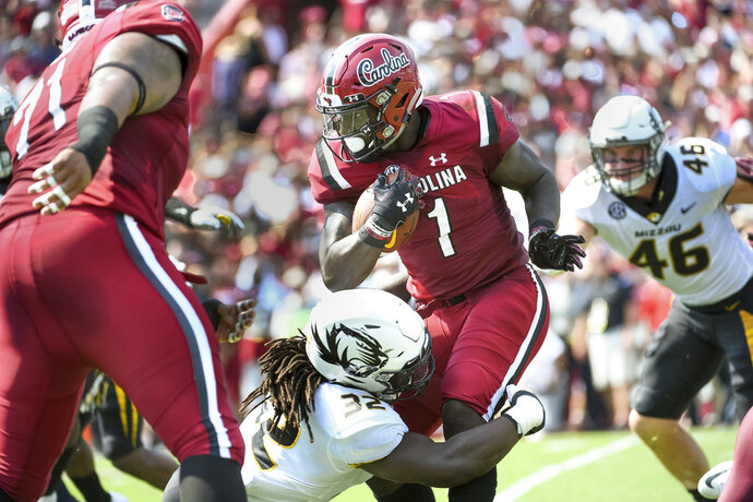 South Carolina wide receiver Deebo Samuel (1) runs with the ball against Missouri linebacker Nick Bolton (32) during the first half of an NCAA college football game Saturday, Oct. 6, 2018, in Columbia, S.C. (AP Photo/Sean Rayford)