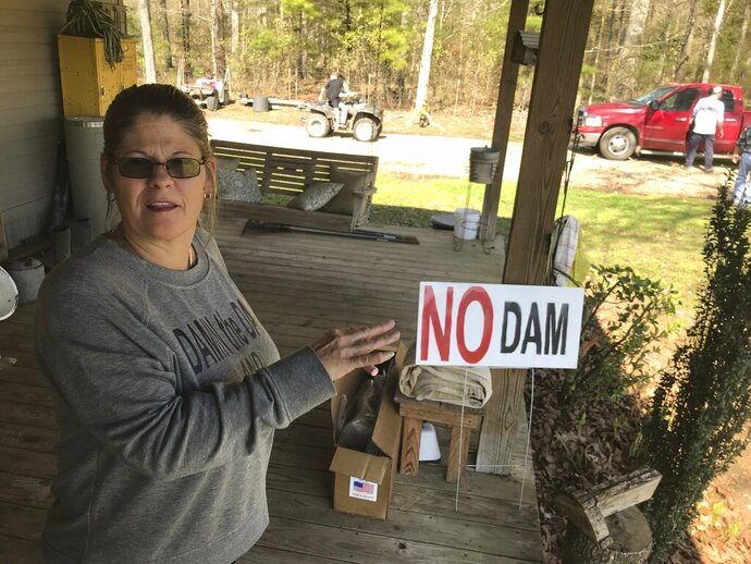 Lisa Tynes chats Saturday, Feb. 8, 2020, on her front porch as her handiwork, the