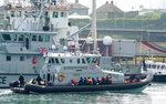 A group of people thought to be migrants are brought into port aboard a Border Force vessel, at Dover, England, Monday July 26, 2021.  The group of people were picked up by the border force vessel following a small boat incident in the Channel. (Gareth Fuller/PA via AP)