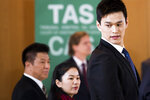Swimmer Sun Yang, right, from China, arrives for a  public hearing at the Court of Arbitration for Sport (CAS) in Montreux, Switzerland, Friday, Nov. 15 2019. One of China's biggest Olympic stars and three-time gold medalist swimmer Sun Yang is facing a World Anti-Doping Agency appeal in Switzerland that seeks to ban him for up eight years for allegedly refusing to give samples voluntarily. (Jean-Christophe Bott/Keystone via AP)